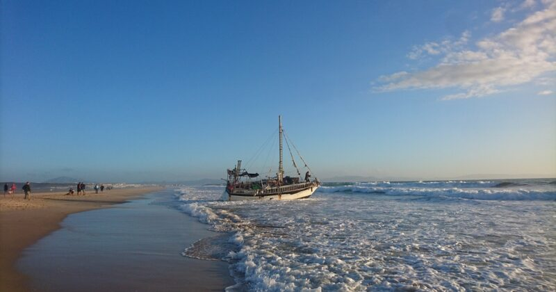 Sailboat Washes Ashore On The Beach In Tarifa